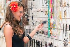 Woman is choosing jewerly Stock Photo