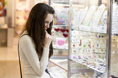 Woman is choosing jewerly Stock Photography