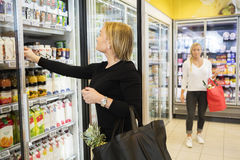 Woman Choosing Juice Packets In Grocery Store Stock Photography