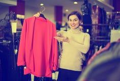 Woman choosing knitwear cardigan Stock Image