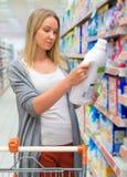 Woman choosing laundry detergent. Stock Photos
