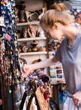 Woman choosing leather jewelry bracelets at the handmade craft market. Woman choosing leather jewelry bracelets at the handmade craft market royalty free stock image