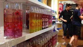 Woman choosing liquid scent on display shelf Royalty Free Stock Images
