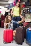 Woman choosing luggage bag in shop Stock Photos