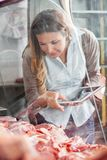 Woman Choosing Meat At Butchery Royalty Free Stock Photos