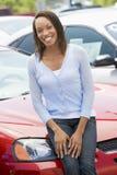 Woman choosing new car. At dealership Royalty Free Stock Photography