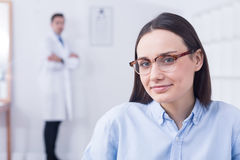 Woman choosing new eyeglasses Royalty Free Stock Photography