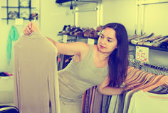 Woman choosing new long sleeve blouse Royalty Free Stock Image