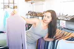 Woman choosing new long sleeve blouse Stock Images