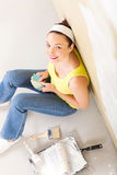 Woman choosing paint color Stock Images