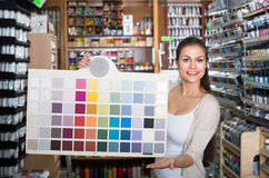 Woman choosing paint color Royalty Free Stock Image
