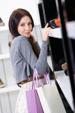 Woman choosing a pair of pumps in shop Stock Photo