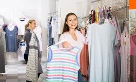 Woman choosing pajamas in lingerie shop Stock Photo