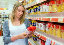Woman choosing pasta. Royalty Free Stock Image