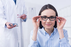 Woman choosing the perfect glasses stock photos
