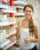 Woman choosing perfume in the store Stock Photo
