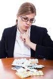 Woman choosing pills Stock Photo