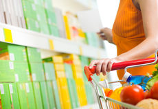 Woman choosing products on shelf Royalty Free Stock Photography