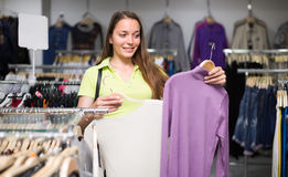 Woman choosing pullover in shop Stock Photo
