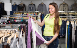 Woman choosing pullover in shop Royalty Free Stock Photography