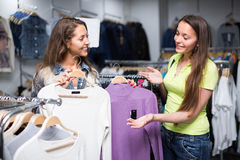 Woman choosing pullover in shop Royalty Free Stock Image