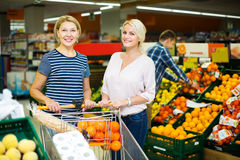 Woman choosing seasonal fruits Royalty Free Stock Image