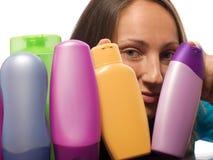 Woman choosing shampoo Royalty Free Stock Photography
