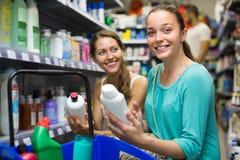 Woman choosing shampoo at store Stock Image