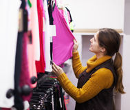 Woman choosing shirt at clothing store Stock Photos