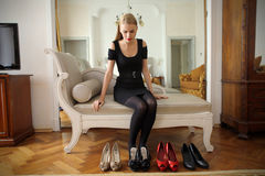 Woman choosing shoes Royalty Free Stock Photos