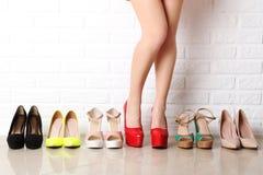 Woman choosing shoes Royalty Free Stock Image