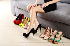 Woman choosing shoes Royalty Free Stock Images