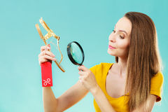 Woman choosing shoes searching through magnifying glass Stock Photos
