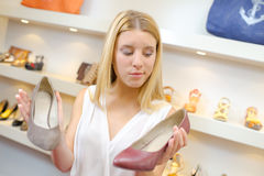 Woman choosing shoes in shop Royalty Free Stock Photos