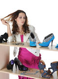 Woman choosing shoes at a store Royalty Free Stock Images