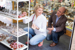 Woman choosing shoes in store Royalty Free Stock Images