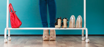 Woman choosing shoes to wear in mall or wardrobe Stock Photos