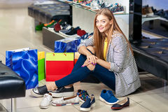 Woman choosing shoes Royalty Free Stock Photography