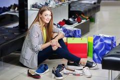Woman choosing shoes Stock Photos