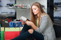 Woman choosing shoes Stock Photography