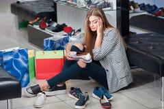 Woman choosing shoes Stock Image
