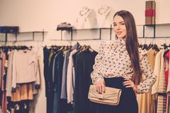 Woman choosing in a showroom Royalty Free Stock Images