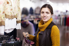 Woman choosing skirt at clothing store Royalty Free Stock Images