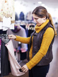Woman choosing skirt at  store Royalty Free Stock Photography
