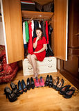 Woman choosing between sneakers and high heeled shoes Stock Images