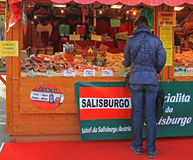 Woman is choosing something to buy in Bergamo. Bergamo, Italy - December 2, 2015: woman is choosing something to buy in Bergamo Royalty Free Stock Photo