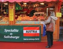 Woman is choosing something to buy in Bergamo. Bergamo, Italy - December 1, 2015: woman is going to buy something at the christmas fair in Bergamo, Italy Stock Photos