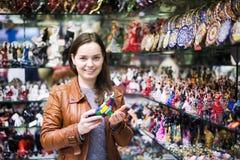 Woman choosing souvenir Royalty Free Stock Images
