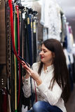 Woman choosing strap at shop Royalty Free Stock Images