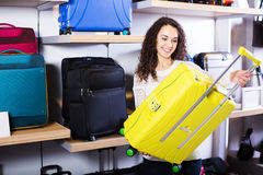 Woman choosing suitcase in shop Stock Image